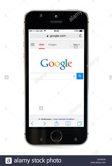 Google home page on an Apple iPhone 5S, UK Stock Photo