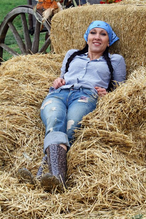 Woman Farmer Resting In Hay Stock Images - Image: 21849684