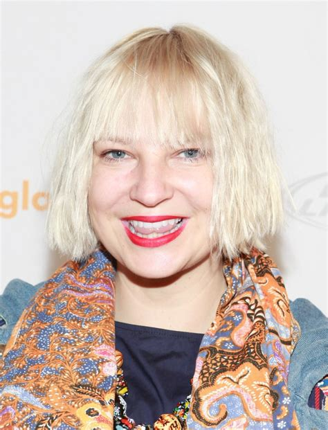 Why Does Sia Cover Her Face With a Wig? Here's the Answer